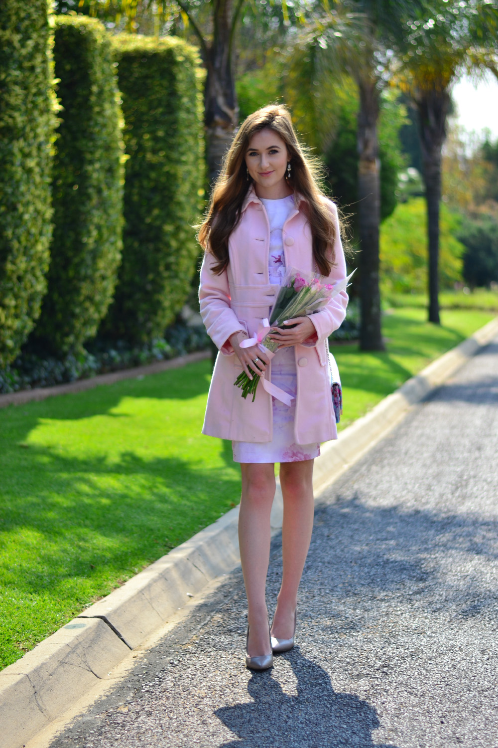 roses and a pink coat