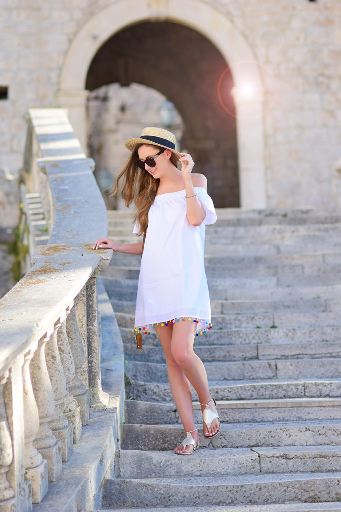Korčula, Croatia – Brett Robson Off-The-Shoulder Pom Pom dress